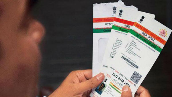 Good news to NRIs:center approves issuance of Aadhaar number
