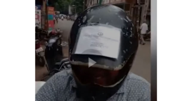 man carries all his vehicle-related documents on the helmet,
