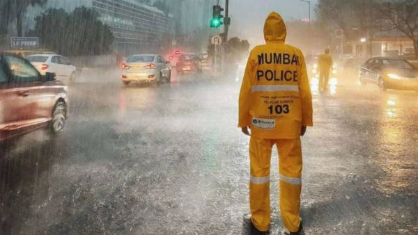 Mumbai rains stop life in the city for all but traffic cops. Internet hails the heroes