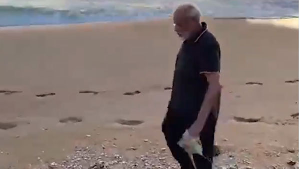 PM Modi in his morning walk in cleans kovalam beach