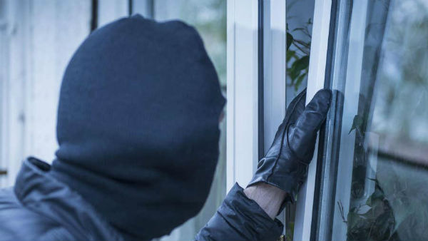 Intruded into the house and threatened ... robbery in Shamshabad