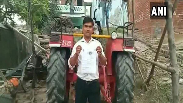 Tractor driver fined Rs 3,000 for driving without helmet, licence in Hapur