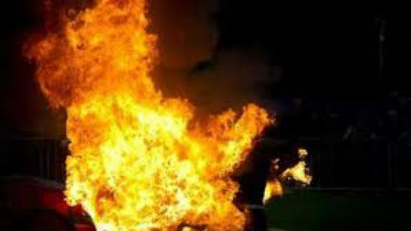 A married woman set fire her husband to death
