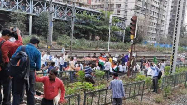 Mumbai commuters clash with anti CAA protestors who sat on railway tracks