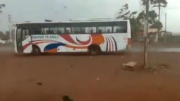 Heavy winds forced a bus to move back in sathupalli in khammam district.