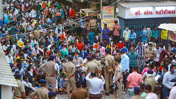 Stranded migrant workers clash with police in Surat, demand to be sent home..