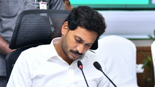 ap government suspends guntur dccb employee for social media posts against jagan