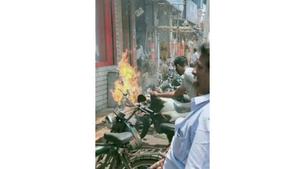 people panic after sanitizer burnt in a bike in rajahmundry