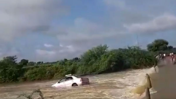 A car washed away in stream near Gooty in Ananthapur district as narrow escape for two people