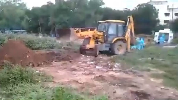 JCB takes COVID 19 patients dead body to the burial at Tirupati in Chittoor district