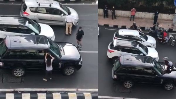 Suspecting husband of having an affair, woman blocks his car on road..