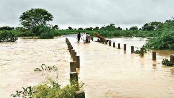 telangana rains man washed away in floods while crossing a gorge