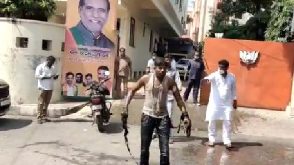 supporting bandi sanjay, a Man tries to immolate self in front of BJP office in Hyderabad