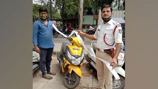 Facing Rs 42,000 in traffic fines, Bengaluru vegetable vendor hands over bike to police