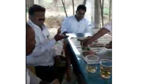 Alcohol drunken MEO and teachers played poker at school in adilabad district