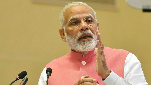 committed for privatization of psus: modi