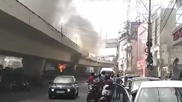 fire accident under panjagutta flyover in hyderabad, traffic stopped a for while