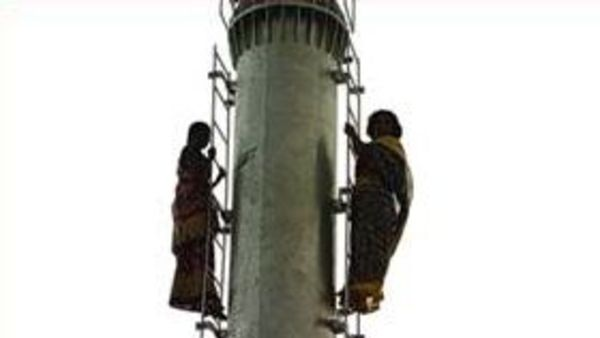 two women climbs cell phone tower to demanding its removal