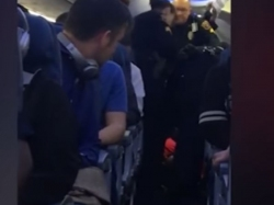 Watch Woman Get Dragged Off Jet Police Detroit