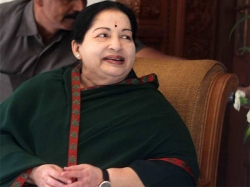 Tamilandu Finance Minister Visits Jayalalithaas Tomb With Bu
